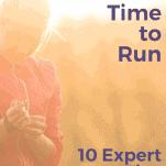 female runner adjusting watch before run
