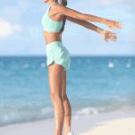 female runner jumping on beach