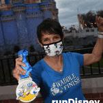 female runner rundisney virtual race castle with medal