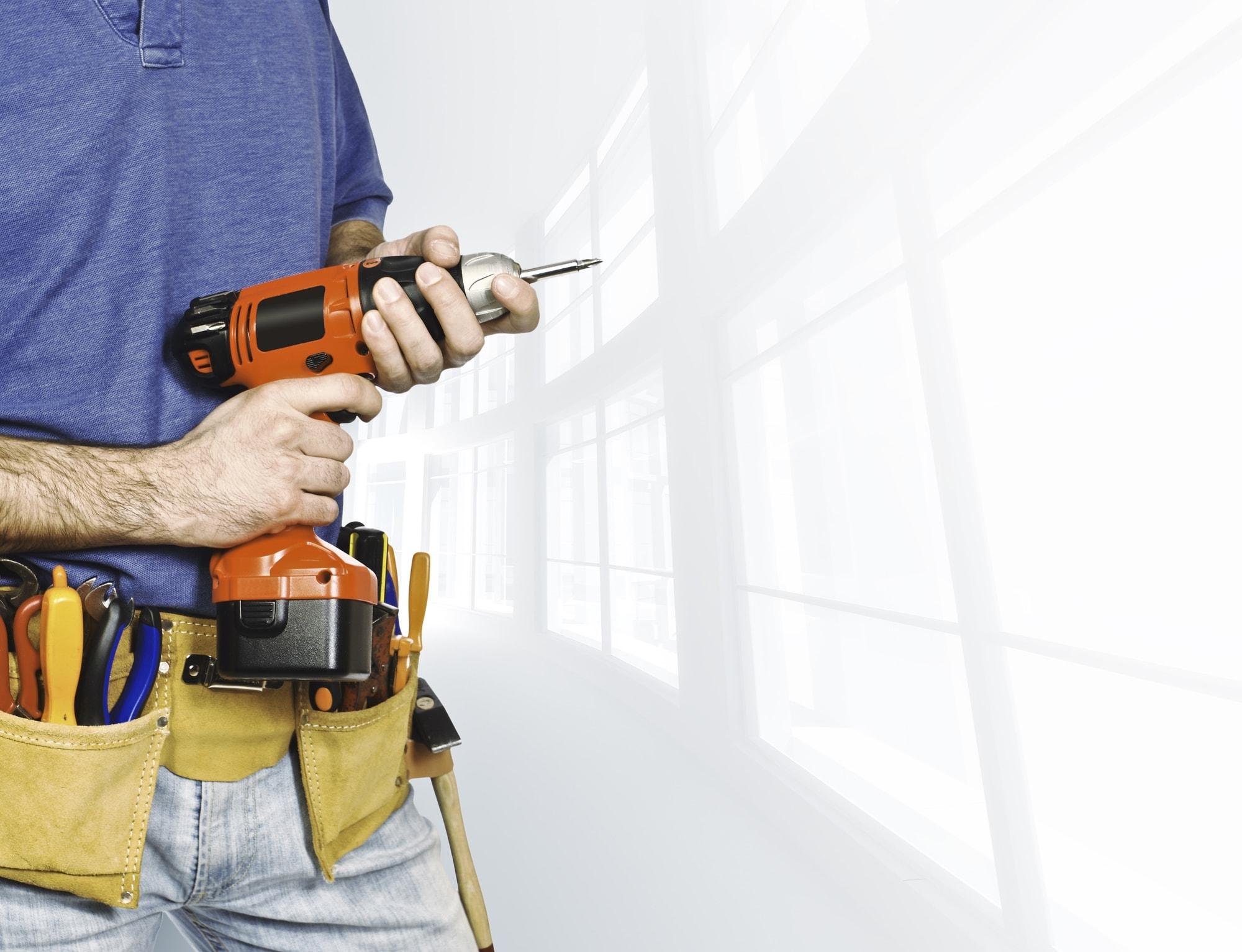 Man holding a screwdriver