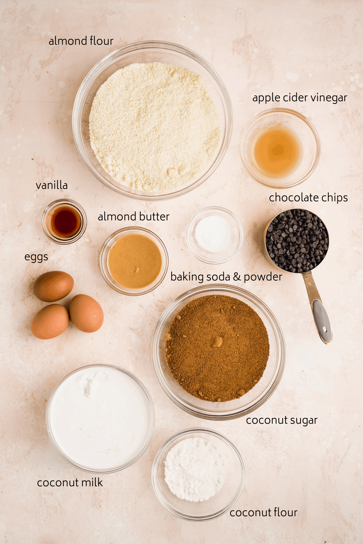 Ingredients list for cookie dough cake on pink surface.