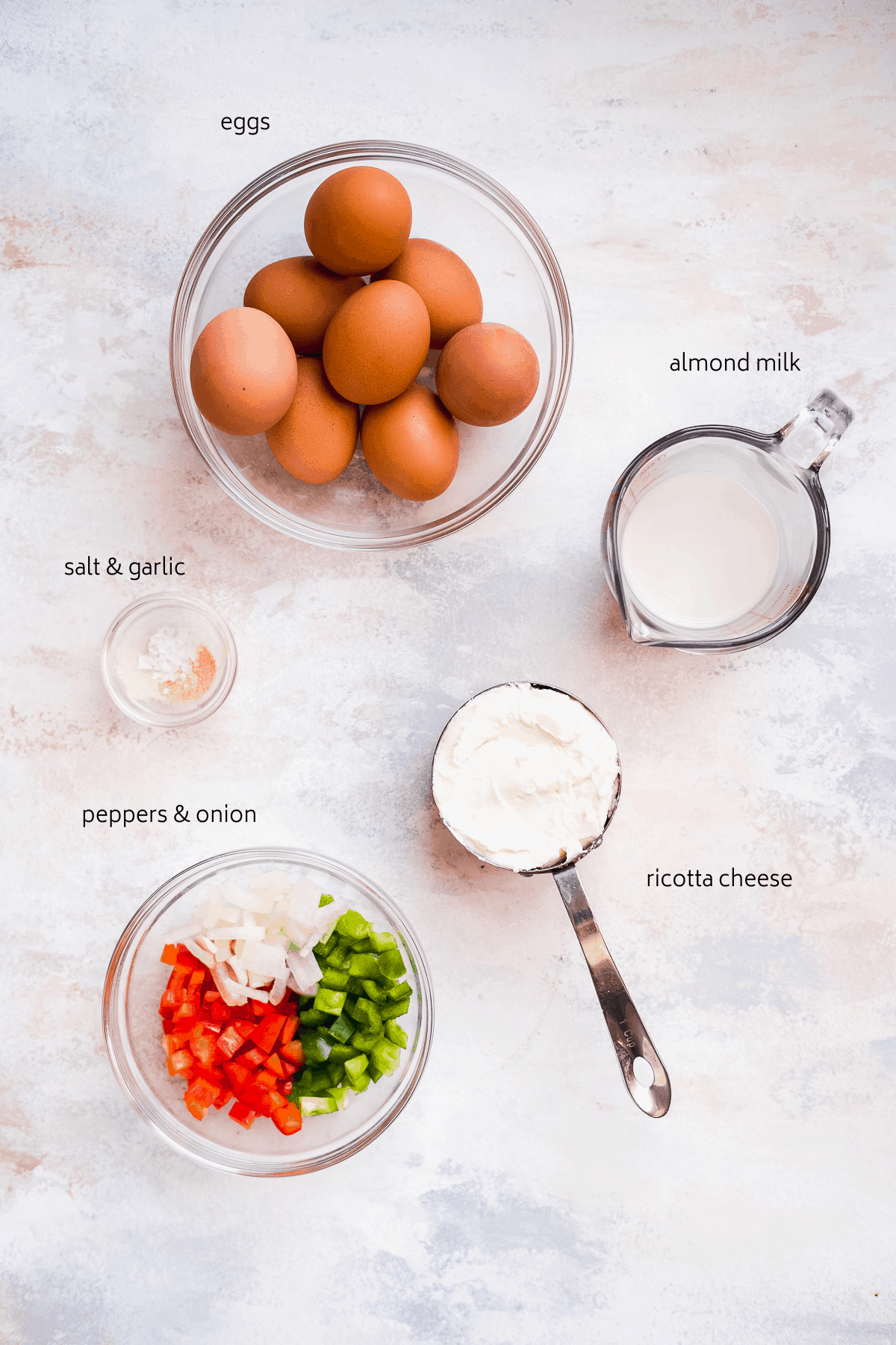 Image of ricotta egg bite ingredients on a surface with black labels.