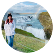 Dr. Meghan T. Lee of Horizon Neuropsychological Services, Littleton, Colorado standing in front of a waterfall