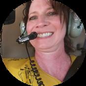 Robin Liebgott sitting in a helicopter