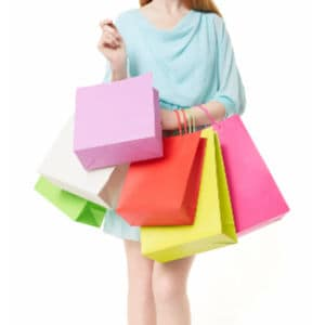 woman holding pastel colored shopping bags