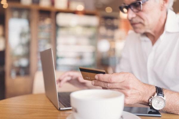 Senior Man Shopping Online On Lap Top