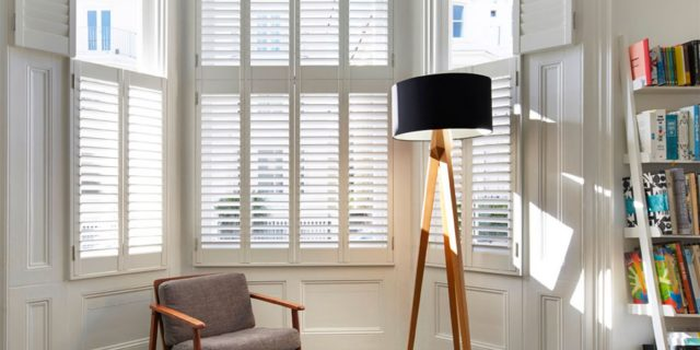 Tier-on-tier shutters fitted to a living room sash window in Brighton & Hove
