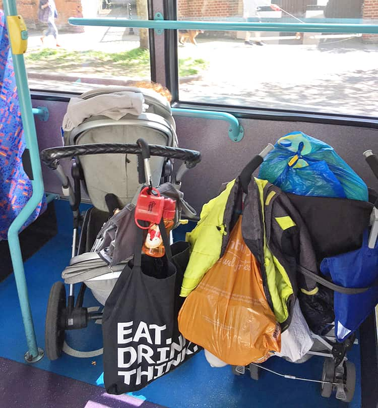 Joolz double pram on a London bus, beside a single pram