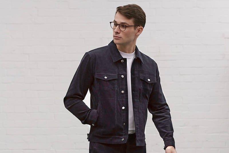 man wearing denim jacket