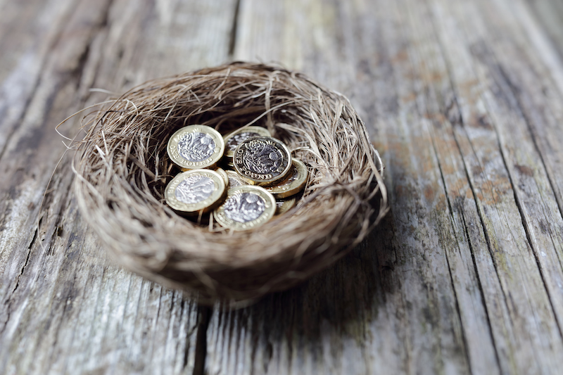 a nest full of new british pound coins representing an additional payment