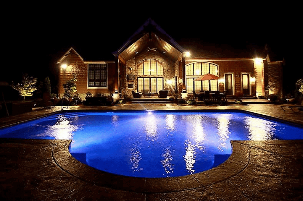 spectacular night time view of pool and the home.