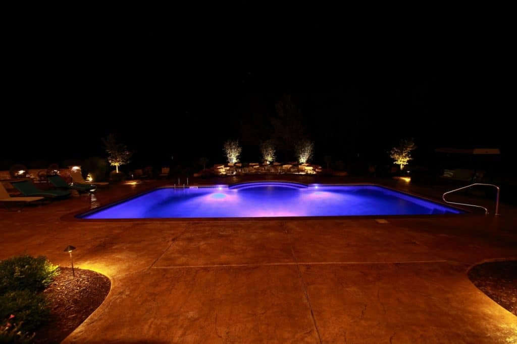 spectacular night time view of pool from the home.