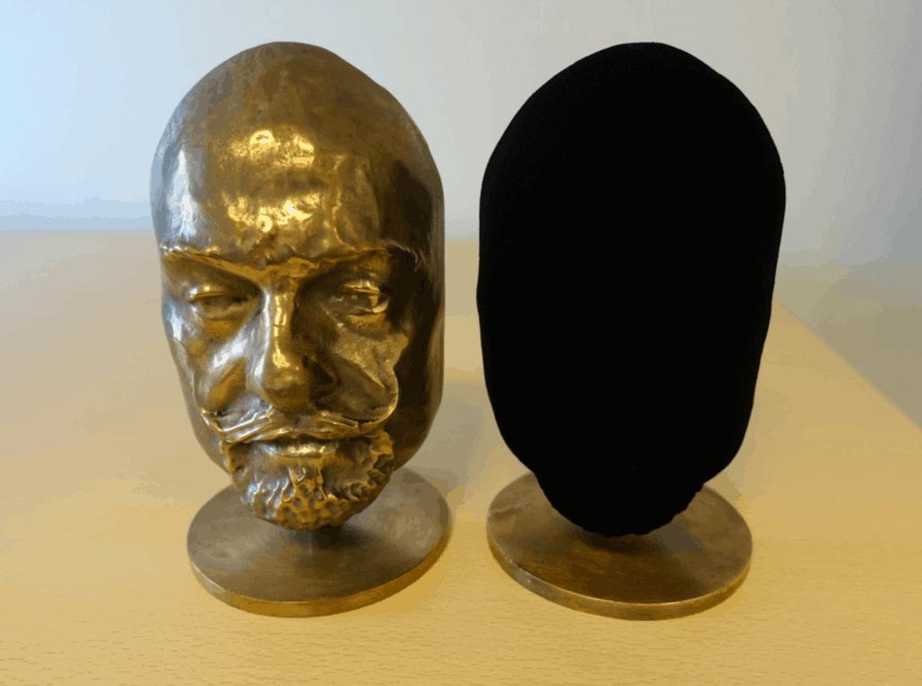 Two identical busts. One coated in Vantablack. Blackest black
