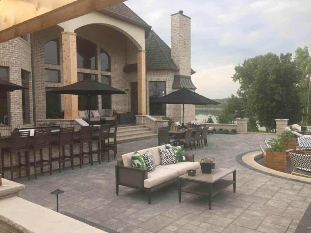 backyard patio with stone matching home