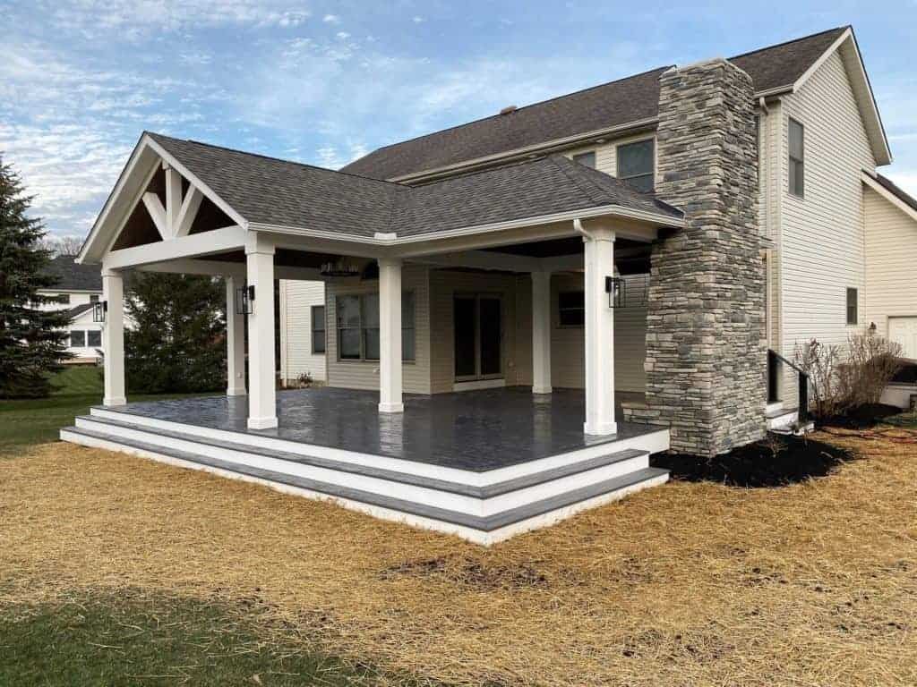 home extension features outdoor amenities including fireplace and sound system.