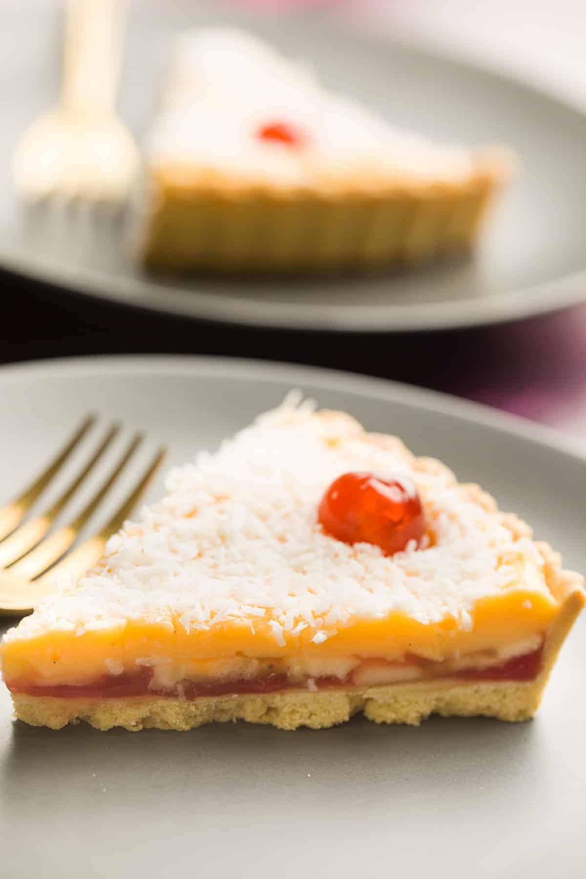 A slice of jam and custard tart.