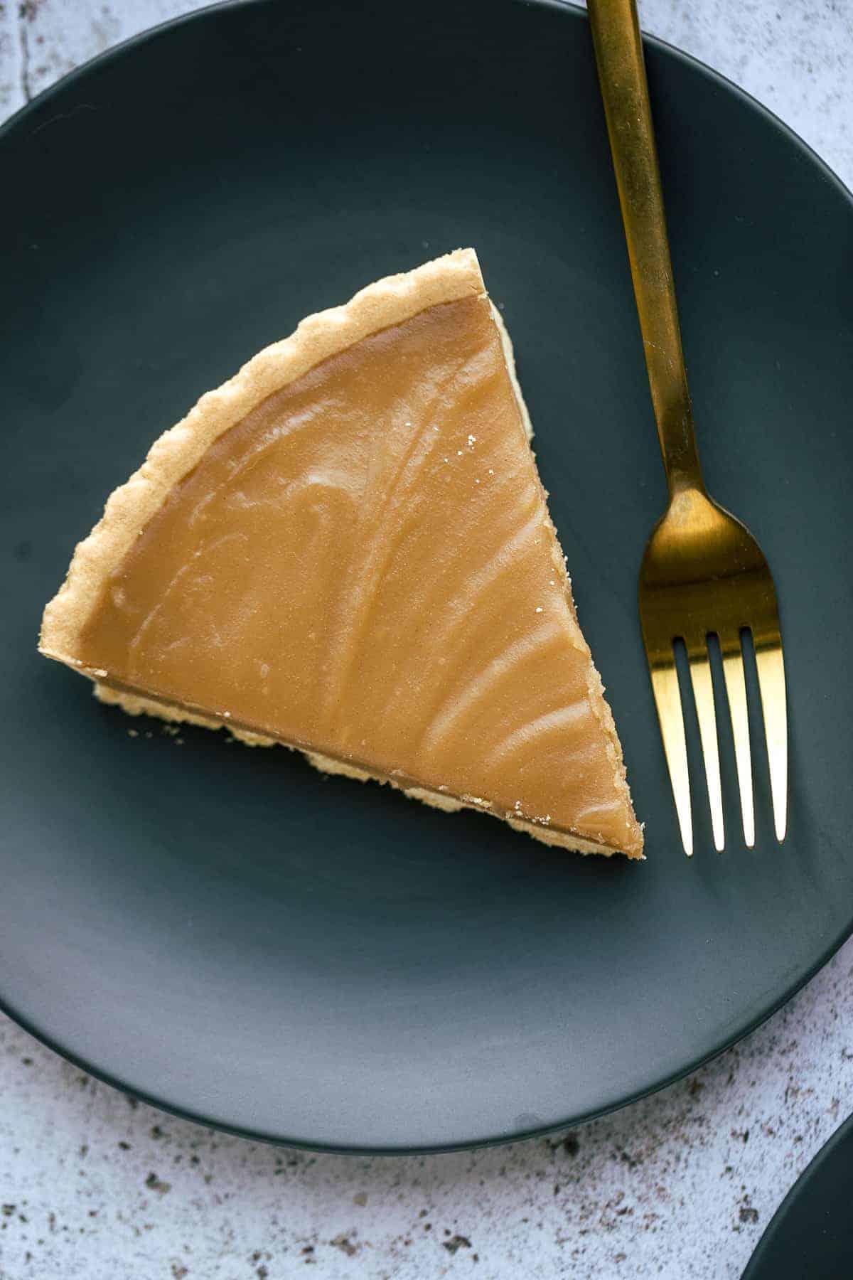 A single slice of a caramel tart.