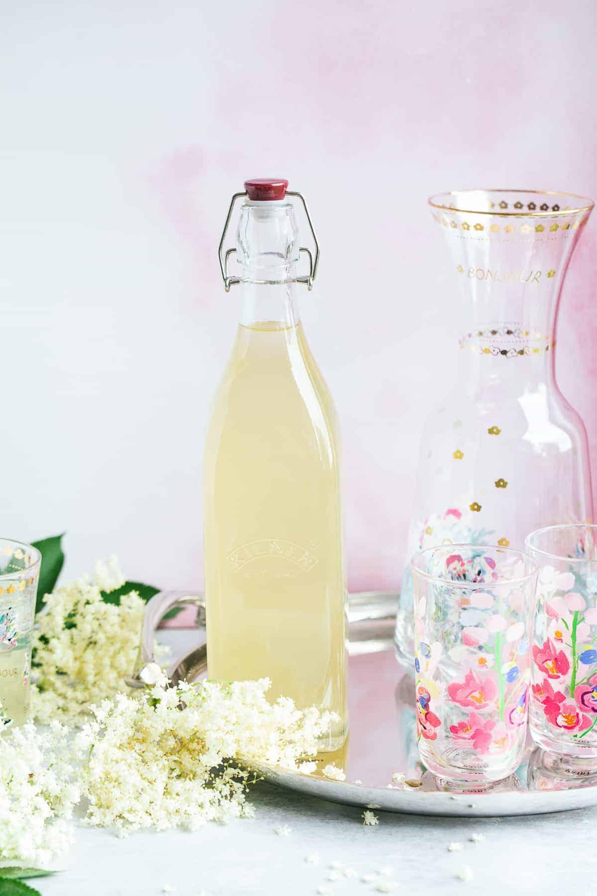 A bottle of fizzy elderflower cordial.
