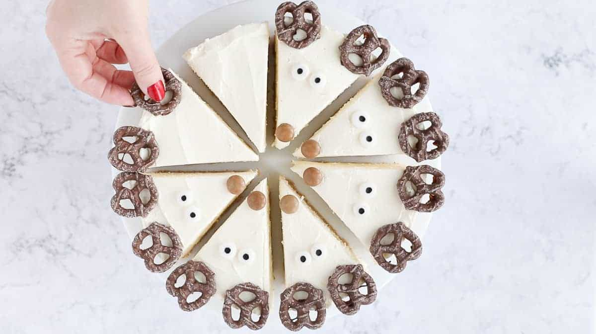 Decorating a cheesecake to make it look like reindeer.
