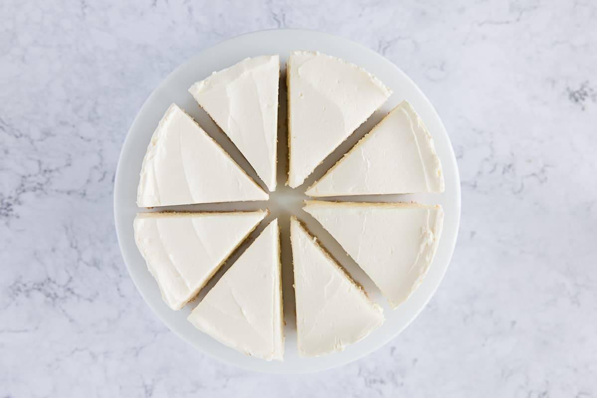 A no bake vanilla cheesecake cut into 8 slices.