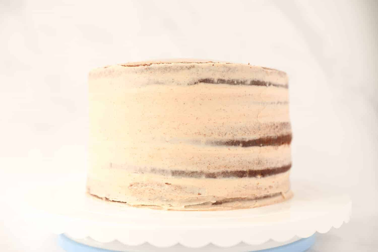 Side profile of a five layer chocolate cake that has been iced with nutella buttercream.