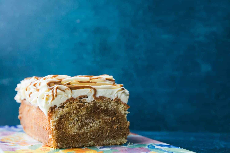 A loaf cake on a flowery cake board.