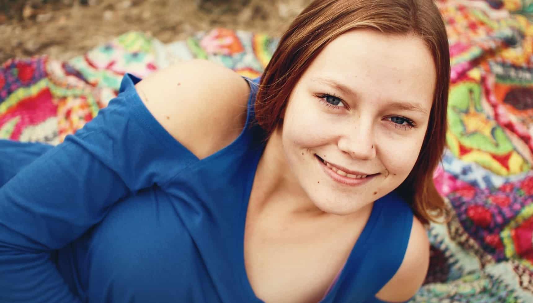teen girl in blue top