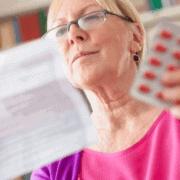 woman reading drug information