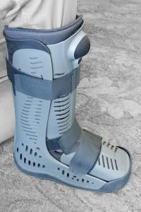 Modern compression boot a popular alternative and post plaster cast support recommended by doctors to provide support on a broken or fractured bone following a serious injury.