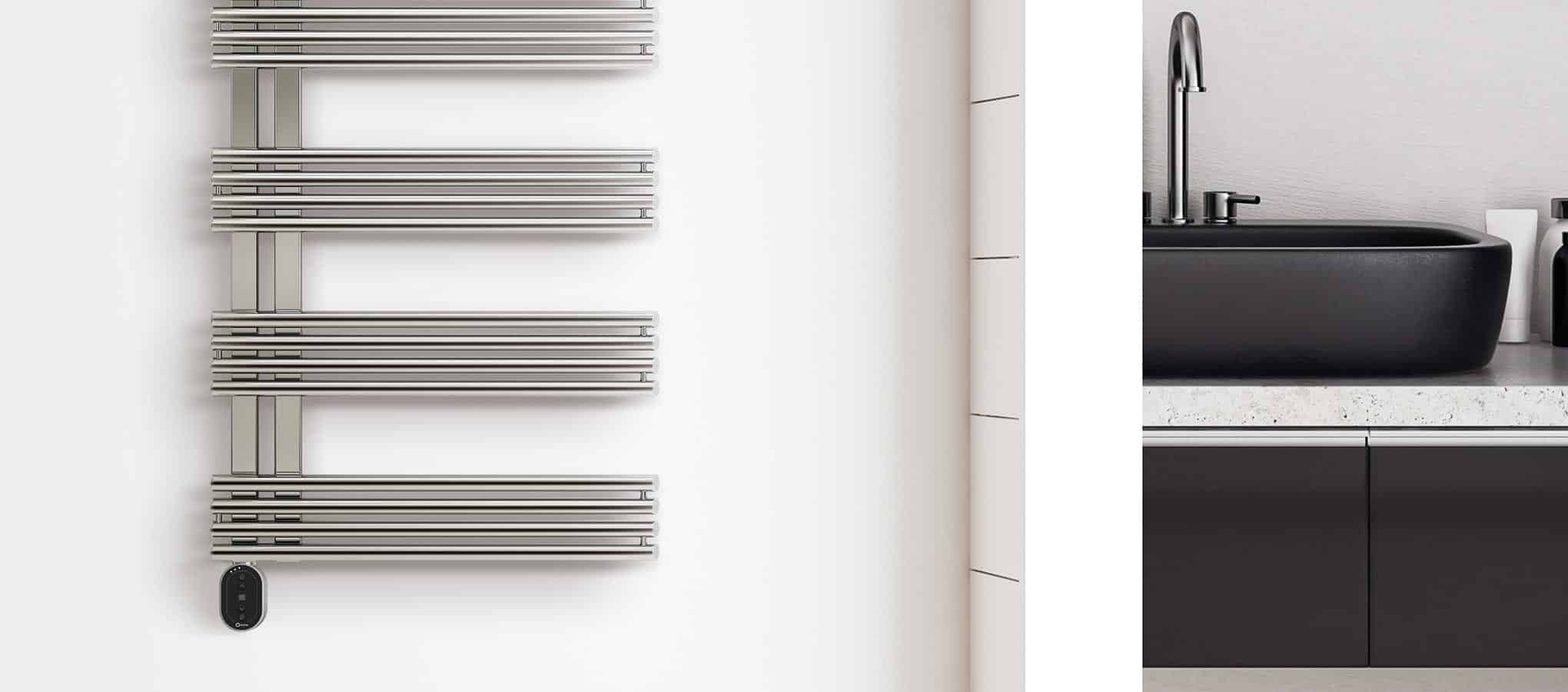 Rointe Impero electric towel rail with Oval control panel in a white bathroom