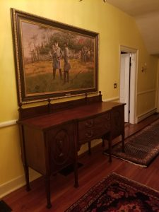 Antique Sideboard under Painting