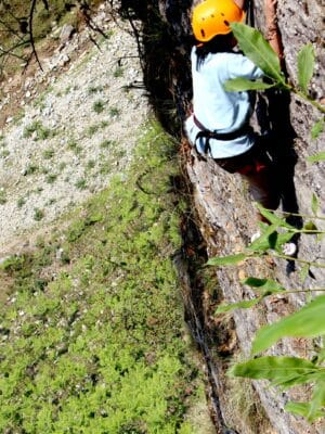 A Adventure enthusiast doing rock climbing at chopta in uttarakhand.
