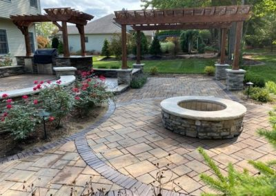 Pergola and Fire pit with intricate brick patio