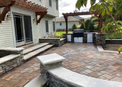 Outdoor Kitchen with Pergola intricate flooring design