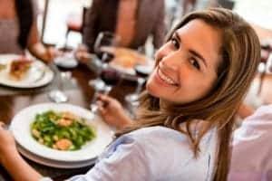 Happy woman having dinner at a restaurant