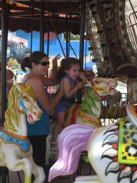 Bella holds on for dear life on the carousel at Deno's Wonder Wheel amusement park