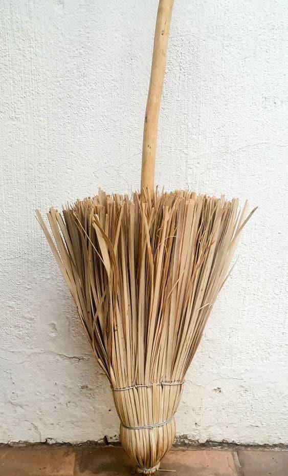 After turn the broom around. #broomrepurpose #broomchristmastree #acraftymix #broomdecor #christmastree #DIYChristmasTree