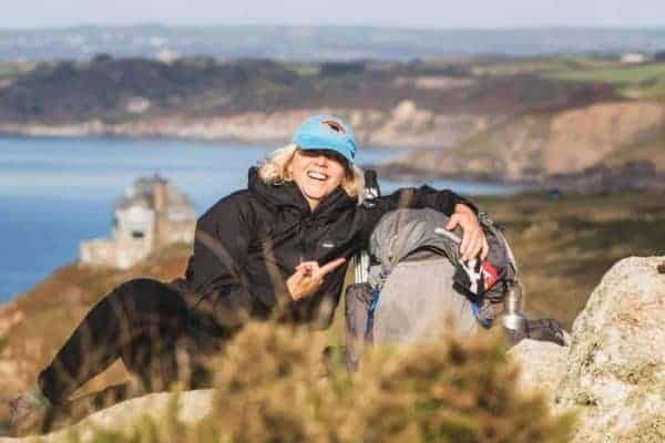 Gail in Cornwall with backpack.