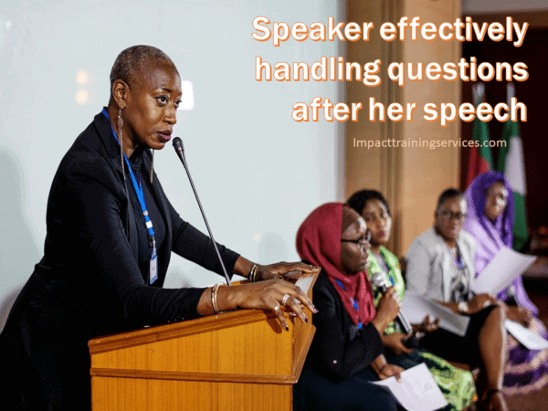 cover image of woman at lectern handling questions effectively after speech
