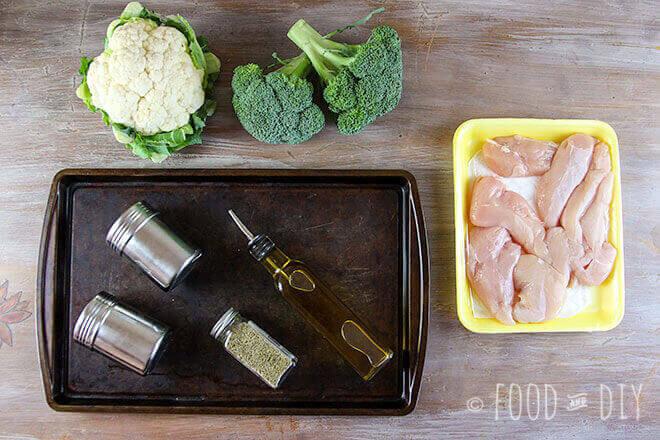 cookie sheet, seasonings, broccoli, cauliflower, raw chicken