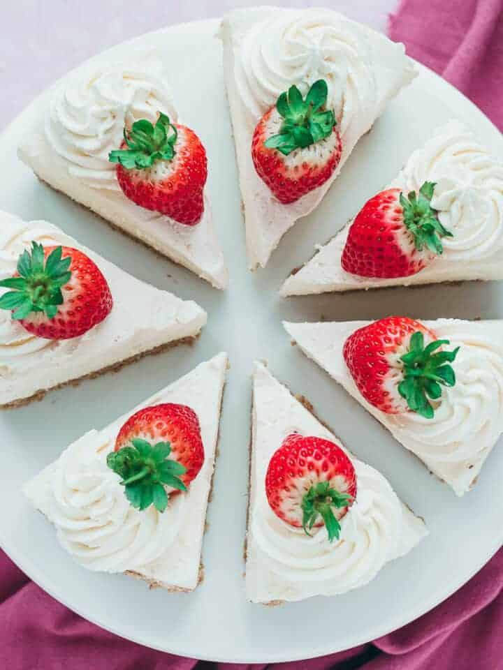 Overhead of a vanilla no bake cheesecake cut into 7 slices.
