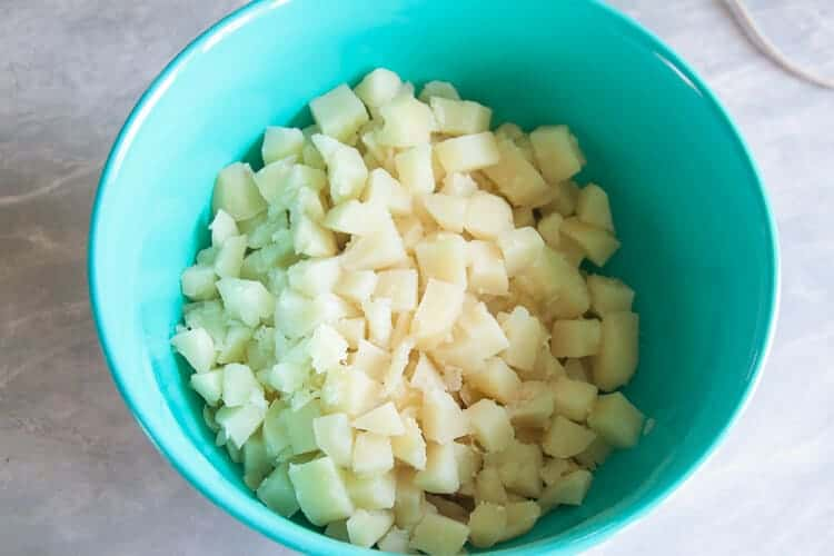 peeled and boiled potatoes in a bowl