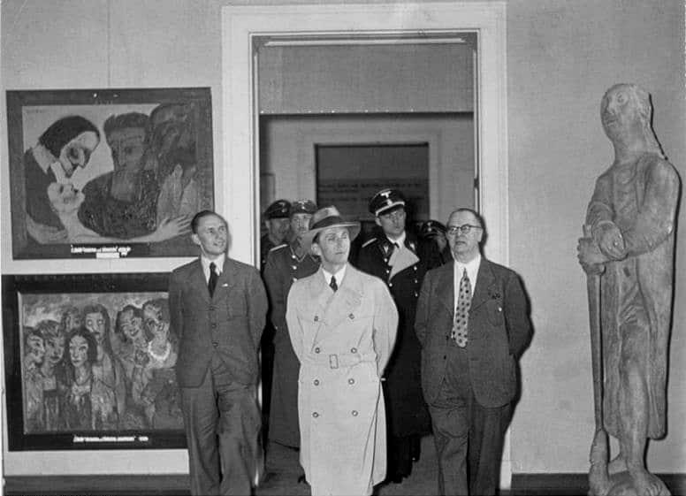 Joseph Goebbels, Reich Minister for Public Enlightenment and Propaganda, walking in the Degenerate Art Exhibition in Munich, 1937
