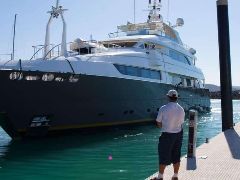 Coral Sea Marina staff welcoming a superyacht that is arriving into Coral Sea Marina