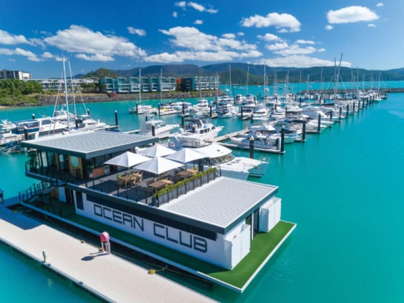 aerial of the floating Ocean Club customer crew lounge at Coral Sea Marina