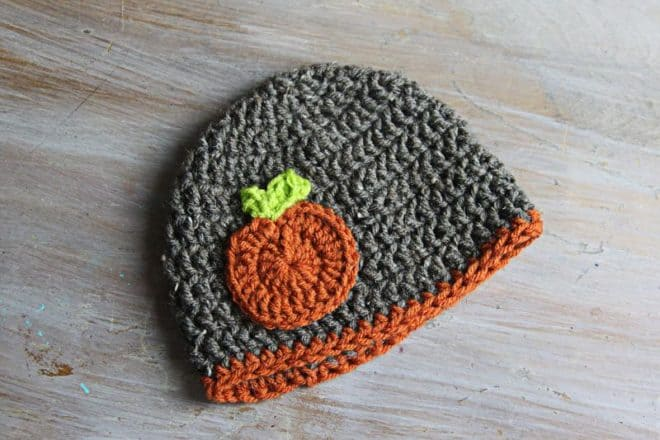 This adorable Crochet Pumpkin Applique is so easy and makes a perfect gift. I have one on a coffee cozy and one on a beanie for the new baby. It would also be cute on a crochet ear warmer headband.