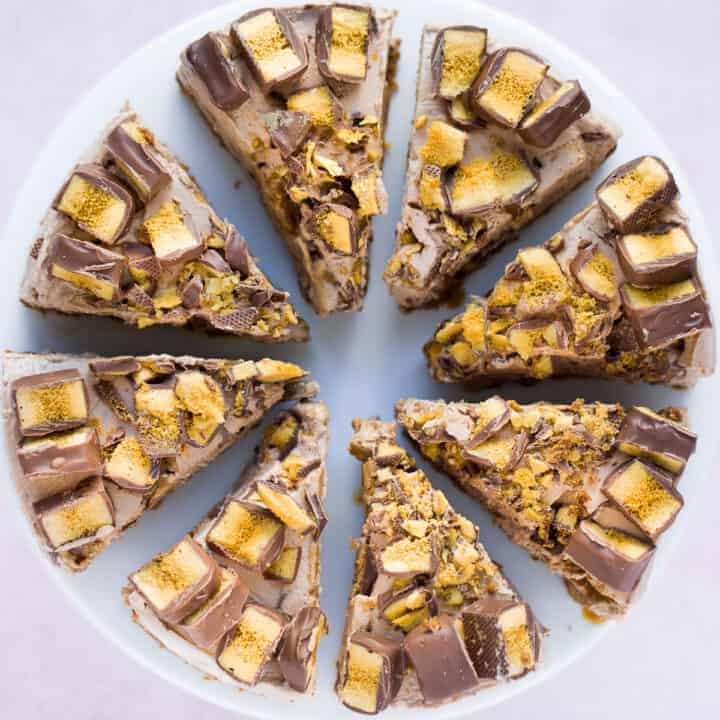A no bake Crunchie Cheesecake cut into 8 individual pieces.